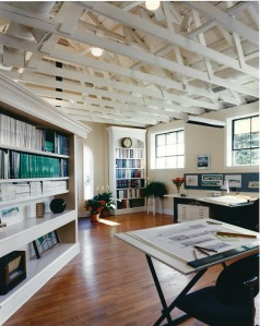 Exposed wood trusses and defining angled wall.