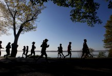 """Record-Eagle/Jan-Michael Stump Bayshore Marathon and Half Marathon competitors run along East Grand Traverse Bay during Saturday's race in Traverse City."""